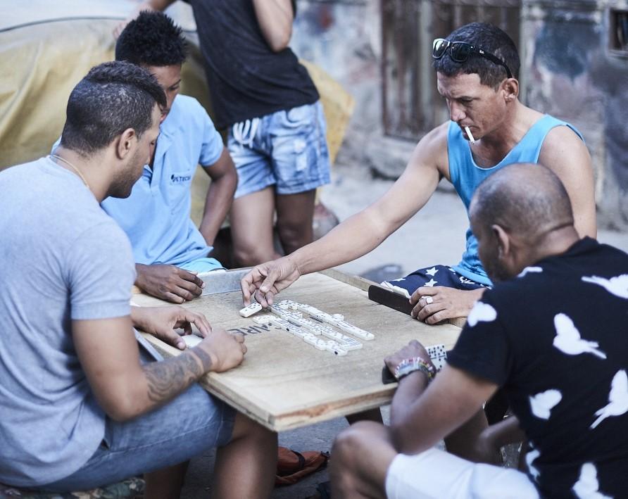 Cubans playing dominoes in the neighborhood.
